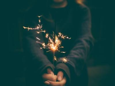 Girl Holding Half Lit Sparkler