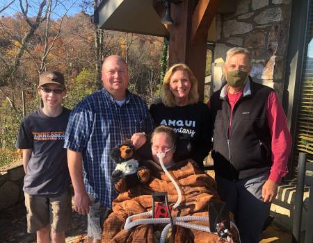 Holloman family enjoys a visit from Tom Goodwin with Mountain Laurel Chalets